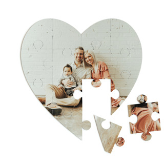 This is a white heart puzzle by Minted Custom called The Big Picture printing on signature in 12 piece.