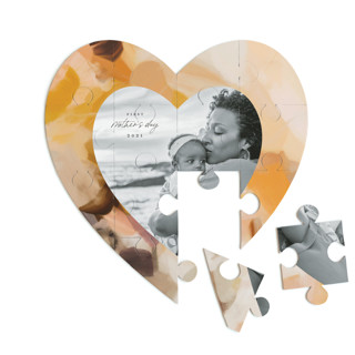 This is a yellow heart puzzle by Parima Studio called Emberley printing on signature in 12 piece.