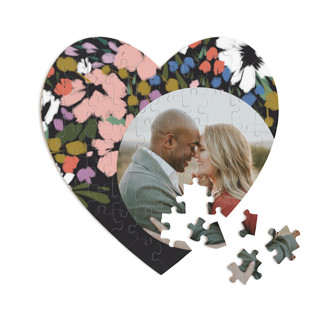 This is a black heart puzzle by Angela Marzuki called spring dream printing on signature in 60 piece.
