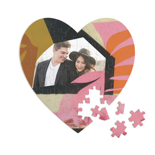 This is a pink heart puzzle by cyrille gulassa called Blaze printing on signature in 60 piece.