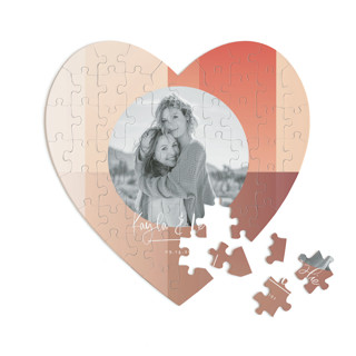 This is a orange heart puzzle by Baumbirdy called Gradient Background printing on signature in 60 piece.