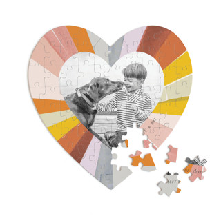 This is a colorful heart puzzle by Baumbirdy called Groovy Kind of Love printing on signature in 60 piece.