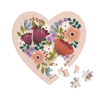 This is a pink heart puzzle by Lauren Brown called Floral Heart printing on signature in 60 piece.