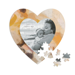 This is a yellow heart puzzle by Parima Studio called Emberley printing on signature in 60 piece.
