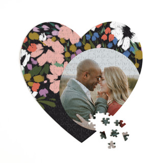 This is a black heart puzzle by Angela Marzuki called spring dream printing on signature in 252 piece.