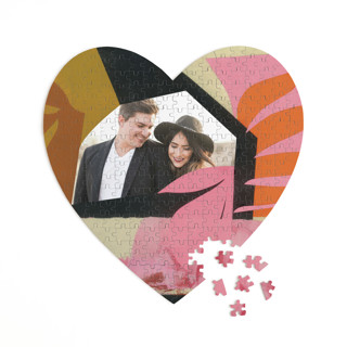 This is a pink heart puzzle by cyrille gulassa called Blaze printing on signature in 252 piece.