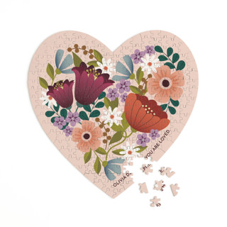 This is a pink heart puzzle by Lauren Brown called Floral Heart printing on signature in 252 piece.