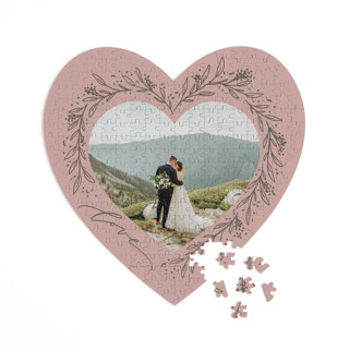 This is a pink heart puzzle by Erin German called Botanical Heart printing on signature in 252 piece.