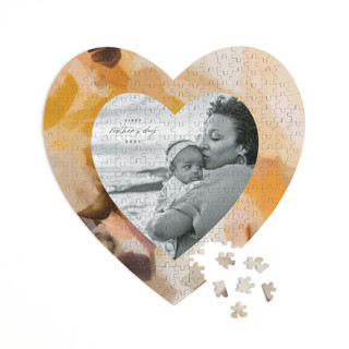 This is a yellow heart puzzle by Parima Studio called Emberley printing on signature in 252 piece.