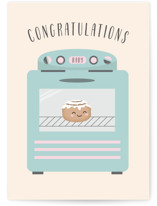 This is a beige new baby greeting card by Annie Holmquist called Bun in the Oven with standard printing on signature in greeting cards.
