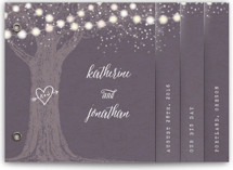 This is a purple wedding invitation minibook card by Hooray Creative called Garden Lights with standard printing on strathmore in minibook.