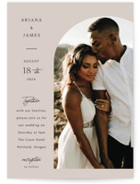 This is a beige petite wedding invitation by Elly called the arch with standard printing on signature in petite.