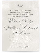 This is a grey wedding invitation by Ariel Rutland called Elegant Crest with standard printing on signature in standard.