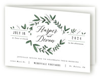 This is a green four panel wedding invitation by Kelly Schmidt called Floral Wreath with standard printing on signature in four-panel.