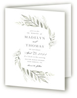 This is a white four panel wedding invitation by Carolyn Nicks called Sweeping with standard printing on signature in four-panel.