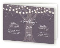 This is a purple four panel wedding invitation by Hooray Creative called Garden Lights with standard printing on signature in four-panel.