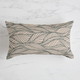 This is a brown pillow by Megan Murrell called Magnolia Leaves.