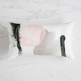 This is a grey pillow by Lori Wemple called Son.