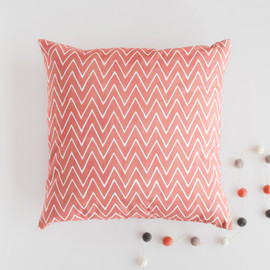 This is a red pillow by Hooray Creative called Watercolor Chevrons.