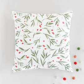 This is a red pillow by Oscar & Emma called Winter Harvest.