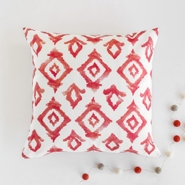 This is a red pillow by Honeybunch Studio called Moroccan Diamonds.