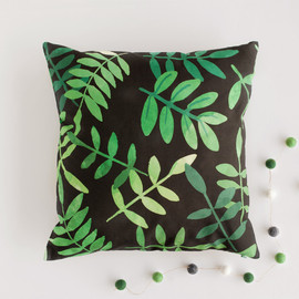 This is a green pillow by Jessie Steury called Botanical.