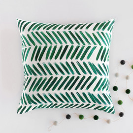 This is a green pillow by Itsy Belle Studio called Brushed Chevron.