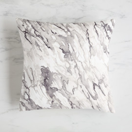 This is a grey pillow by Holly Whitcomb called Watercolor Marble in standard.