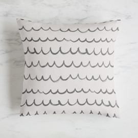 This is a grey pillow by Shirley Lin Schneider called Surf's Up.