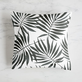 This is a black pillow by Shannon Chen called Palm Leaves in standard.