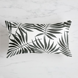 This is a black pillow by Four Wet Feet Studio called Palm Leaves.