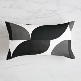 This is a black pillow by Heather Francisco called Mod Wedge.