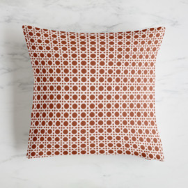 This is a red pillow by Claire Abbiyesuku called Venue.