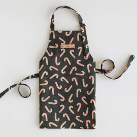 This is a black kids apron by Hooray Creative called Assorted Candy Canes.