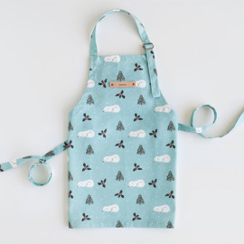 This is a blue kids apron by Cass Loh called Sleeping Polar Bear.