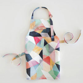 This is a colorful kids apron by Hooray Creative called Kaleidoscope No.1.