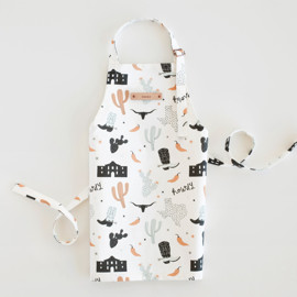 This is a colorful kids apron by Kristie Kern called Texas in standard.