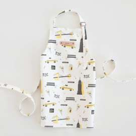 This is a colorful kids apron by Kristie Kern called New York in standard.