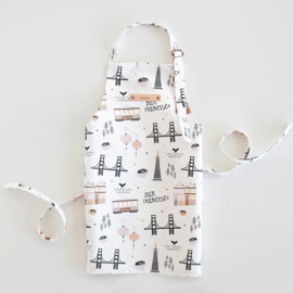 This is a colorful kids apron by Kristie Kern called San Francisco in standard.