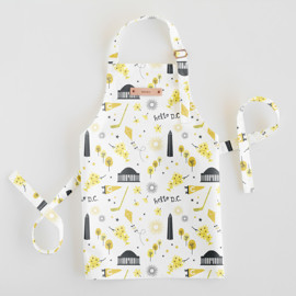 This is a colorful kids apron by Kristie Kern called Washington DC in standard.