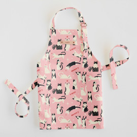 This is a pink kids apron by Vivian Yiwing called Meowy Xmas.