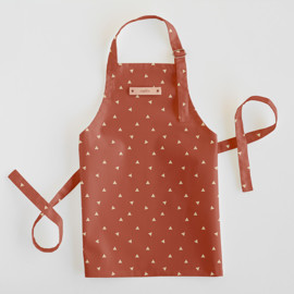 This is a orange kids apron by Cindy Lackey called Golden Triangle in standard.