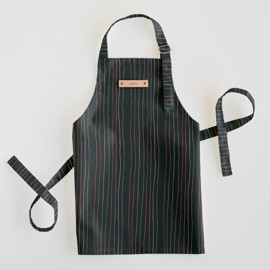 This is a blue kids apron by Multiple Artists called Strands of Tradition 2 in standard.