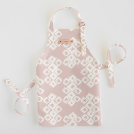 This is a pink kids apron by Zhay Smith called Marrakech Diamond in standard.