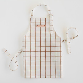 This is a brown kids apron by Carolyn Nicks called Montauk in standard.
