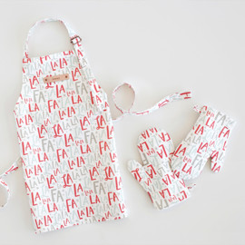 This is a colorful kids apron by Hooray Creative called Festive FaLaLa.