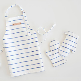 This is a blue kids apron by Melissa Selmin called Breton Stripe.