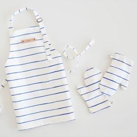 This is a blue kids apron by Melissa Selmin called Breton Stripe.