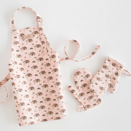 This is a colorful kids apron by Cass Loh called Sleeping Deer.