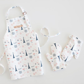 This is a colorful kids apron by Kristie Kern called Bonjour.